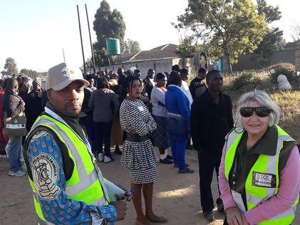 Dr. Mulanda Juma of the Mennonite Central Committee & Peace Appeal Co-Chair, Shirley Moulder at Ruwa township polling station.