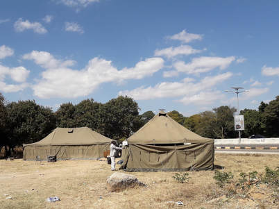 One of the many local polling stations set up in army tents.